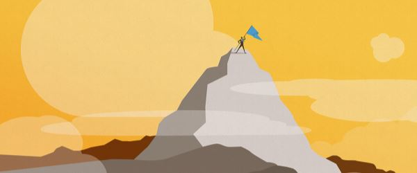 Man on a mountain planting a flag